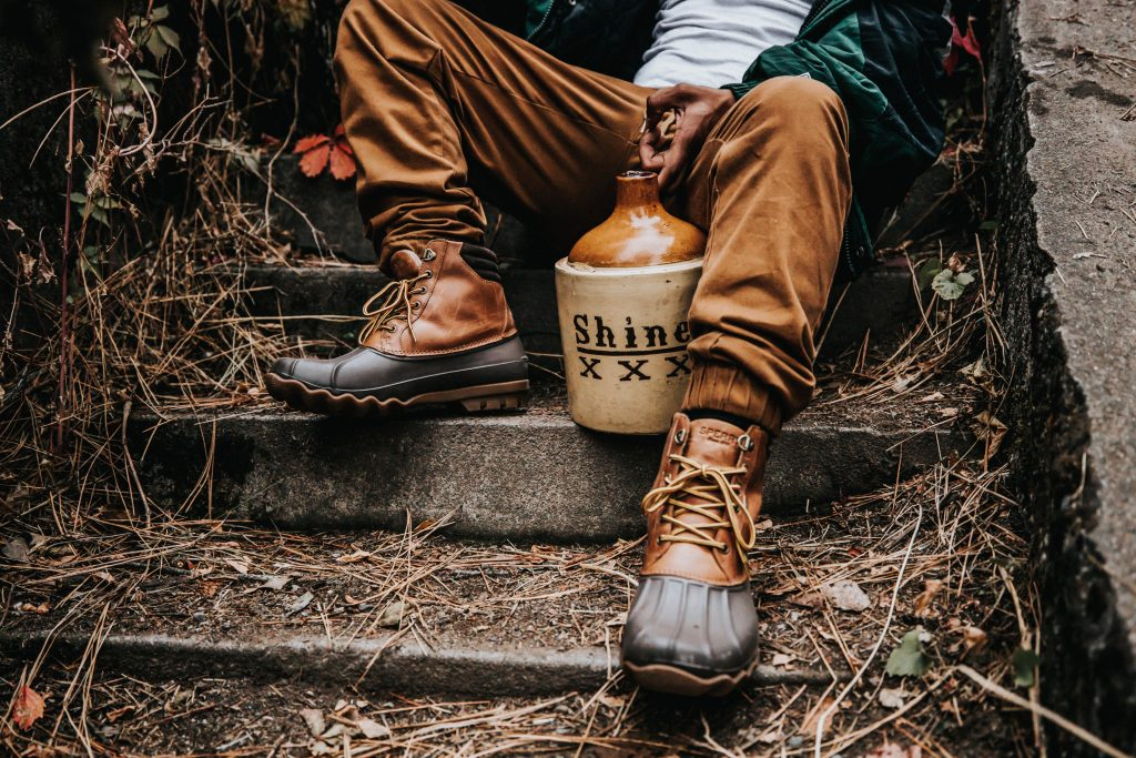 Jango with moonshine bottle and duck boots